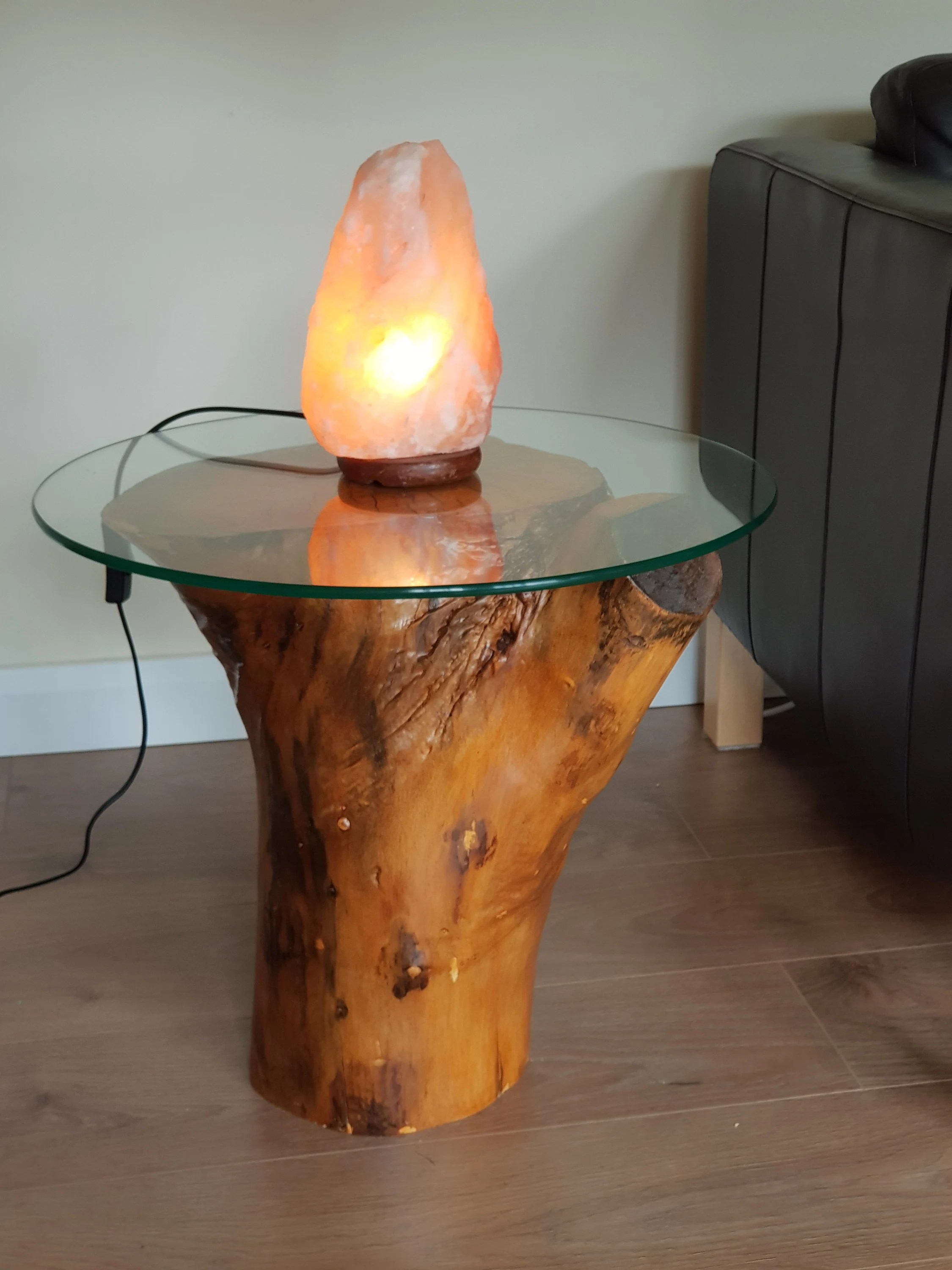 round glass top low coffee table rustic reclaimed tree trunk hardwood decorative display stand minimalist log cabin furniture