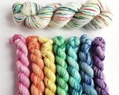 Hand dyed rainbow yarn set pre-order. Pink rainbow speckled mini skeins with optional 100g. Sock yarn, DK yarn. Closes 15th September.