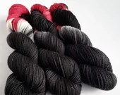Indie dyed silver sparkle sock yarn, superwash merino/nylon/stellina sparkle sock yarn. Vlad - dracula inspired black, red and white yarn.
