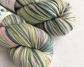 Hand dyed high twist superwash merino/nylon sock weight yarn, fingering/4ply. Dobby, pastel variegated sock yarn for knitting or crochet.