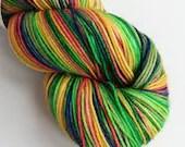 Hand dyed sock yarn, 75/25% superwash merino/nylon sock fingering 4ply weight yarn, variegated rainbow, Christmas sock yarn, red greens gold