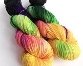 Hand dyed sock yarn, 75/25% superwash merino/nylon sock fingering 4ply weight yarn, variegated black, purple, greens and yellow, Cat People.