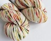 Hand dyed high twist superwash merino/nylon sock/fingering/4ply. Variegated autumnal yarn, Molly, orange, gold, green, red speckled yarn.