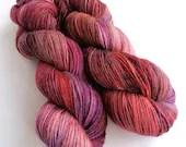 Hand dyed alpaca sock yarn,  60/20/20% superwash merino/superfine alpaca/nylon sock weight fingering 4ply yarn.  Red purple black sock yarn