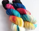 Hand dyed high twist superwash merino/nylon sock weight/fingering/4ply yarn. Nebula variegated rainbow sock yarn with black and white.