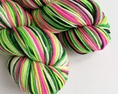 Hand dyed worsted weight wool yarn. Whoville worsted superwash merino wool, hand dyed rios, variegated pink and greens indie Christmas yarn