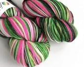 Hand dyed bamboo wool, 80/20% superwash merino/bamboo 4ply/fingering/sock weight yarn. Whoville - hot pink, greens and white variegated.