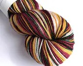 Hand dyed high twist superwash merino/nylon sock weight/fingering/4ply yarn. Vintage Christmas - variegated gold, deep red, green and white.