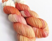 Hand dyed semi-solid sock yarn,  60/20/20% superwash merino/superfine alpaca/nylon sock weight fingering 4ply yarn. Indie dyed peach orange.