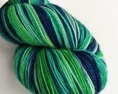 Hand dyed variegated 75/25% superwash BFL/nylon sock weight fingering 4ply yarn in blues and greens.