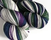 Hand dyed variegated 75/25% superwash merino/nylon sock fingering 4ply weight yarn, Purple, green, navy blue, silver and white yarn.