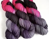 Hand dyed sw merino/nylon dk wool, variegated pink, purple, grey and black double knit. The Blunt End thick sock yarn.