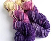 Hand dyed organic merino aran weight yarn for knitting or crochet.  Variegated aran weight wool in pink, purple and yellow.