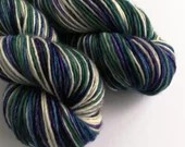 Hand dyed worsted weight singles merino wool yarn. Variegated purple, green, silver, navy and white wool yarn, non-superwash 1ply wool.