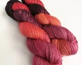 Hand dyed yarn, superwash BFL/silk 4ply/fingering weight yarn, indie dyed, silk blend wool yarn, Reds, orange, black. Discontinued colourway