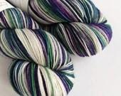 Hand dyed sock yarn, variegated 75/25% superwash BFL/nylon sock/fingering/4ply weight yarn, purple green silver blue white yarn, knitting.