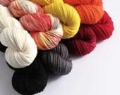 Hand dyed Guy Fawkes yarn set. Black, reds, orange, yellow, grey, white, speckled sock, sparkle yarn, DK yarn. Gunpowder, Treason and Plot.