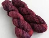 Hand dyed yarn, singles superwash merino 4ply wool yarn, semi-solid dark red purple fingering weight yarn, knitting, crochet wool.