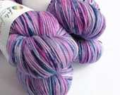 Hand dyed superwash merino dk wool yarn, variegated double knit.  Pink and blue speckled yarn for knitting or crochet.