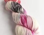 Hand dyed organic fine merino/mulberry silk 4ply/fingering weight yarn. Variegated red, grey, pink and white yarn for knitting or crochet.