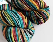 Hand dyed worsted weight wool yarn. Harry worsted superwash merino wool, hand dyed rios, variegated blues, red, gold, black, indie dyed yarn
