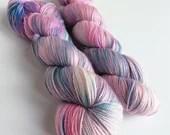 Hand dyed sparkle sock yarn, superwash merino/nylon/stellina sparkle sock/fingering yarn. Shocker pink and turquoise blue sparkle sock yarn.