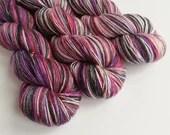Hand dyed variegated yarn - single ply merino/silk 4ply wool. red, purple, black, 1ply yarn, fingering weight.  Discontinued colourway.