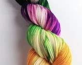Hand dyed superwash merino dk wool yarn, variegated double knit. Cat People bright multi-coloured yarn.