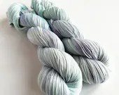 Hand dyed yarn. 50/50% sw merino/cotton 4ply/fingering weight yarn. Arna, semi-solid pastel blues and purples, tonal wool and cotton yarn.