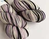 Hand dyed superwash merino dk wool yarn. Variegated double knit wool yarn, Mythic, lilac, silver, white, black indie dyed DK merino yarn.