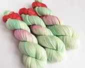 Hand dyed sparkle sock yarn, superwash merino/nylon/stellina sparkle sock/fingering. Pastel green, pink, salmon.  Discontinued colourway