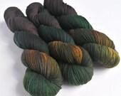 Hand dyed yak sock yarn, variegated sw merino/yak/nylon sock/4ply/fingering. Mutiny gold, black, teal, dark brown fingering weight yarn.