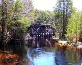 Cedar creek running under old remnant railroad bridge print