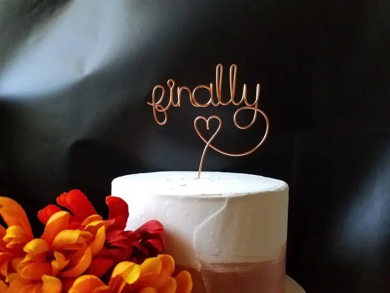A Perfect Wedding Cake Topper in copper wire bent to say Finally