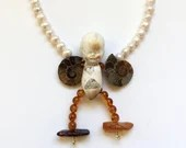 Fly, Beauty, Fly Antique Doll and Amber Necklace
