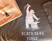 Black Bear Forge Tee shirt, bear working at the anvil