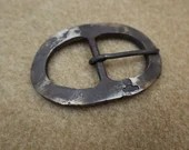 Belt buckle, hand forged between hammer and anvil. Black Bear Forge blacksmith