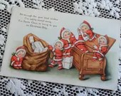 Antique 1918 Postcard Cupie Dolls dressed as Elves Santa's Helpers Christmas Greetings Vintage Post Card 1900s Gifts Chest Santa Claus Sack