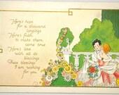Antique Vintage Embossed Color Postcard Gilt Edged Romantic Victorian Couple in Flower Garden 1910s