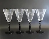Four Clear Crystal Cut Glass Wine Glasses with Black Stems an Elegant Wine Goblet for your Table