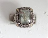 Pale Green Faceted Rhinestone on a Detailed Silver Tone Setting with Gold Accents a Size 6  Gift for Her