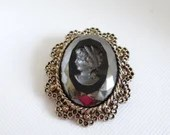 Vintage Victorian Style Black Intaglio Cameo Brooch Pin with Pendant Hardware on Antiqued Gold Scalloped Edge Setting
