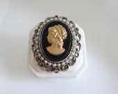 Victorian Style Cameo Brooch Pin with Gold Portrait on Black Background with White Seed Pearl Accents on Antiqued Gold Setting