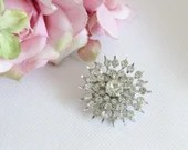 Vintage Clear Faceted Round Glass Rhinestone Brooch Pin on a Silver Tone Setting is an Elegant and Classic Accessory