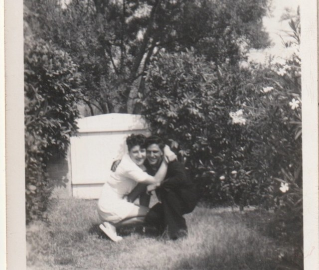 Hide Hugging Couple Crouches Down Behind A Garden Gate To Sneak A Cuddle Vintage Photograph Original Black And White 1 468