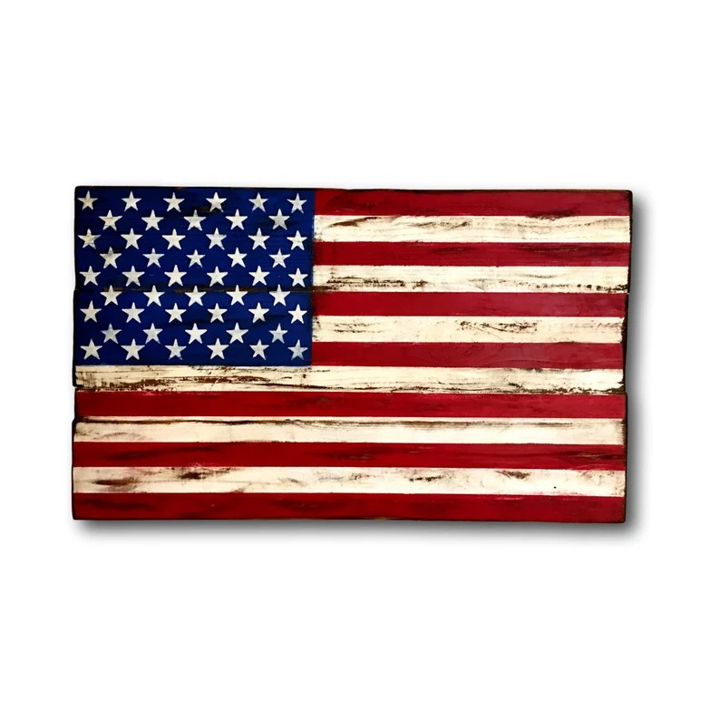 Photo of a wooden painted American flag with white background.