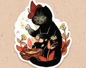 VINYL STICKER - Kitty the witch picking Arnica flowers