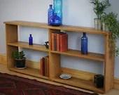 long, low wooden book shelf in natural wood, eco fallen real Oak, 62 high x 143 wide x 22 deep cm, modern rustic handmade in Somerset UK