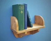 wood wall shelf with book...