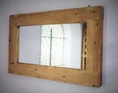 large wall mirror, pale w...